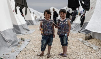Two children in a displaced persons camp in al-Bil, northern Syria, April 21, 2018