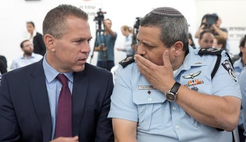 Public Security Minister Gilad Erdan and Israel Police Commissioner Roni Alsheich, July 16, 2018