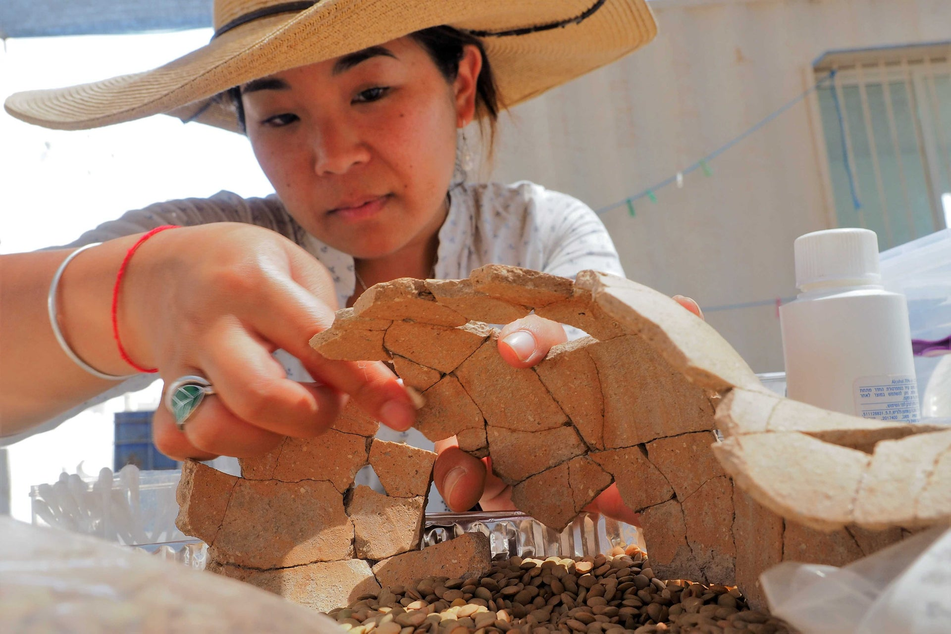 An archaeologist restoring a Bronze Age jar recovered at Tel Shimron