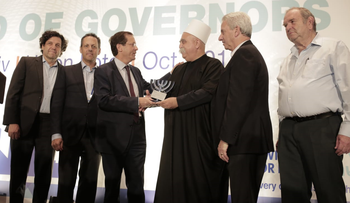 Jewish Agency head Isaac Herzog and Druze leader Sheikh Mowafaq Tarif flanked by Board of Governors Chairman Michael Siegal and Mark Wilf, the incoming chairman of the board of trustees of JFNA.