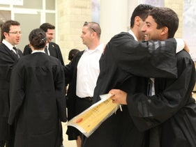ILLUSTRATION: Israeli law students celebrate after passing bar