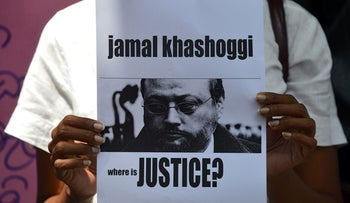 Protester holds a placard with the image of Saudi journalist Jamal Khashoggi outside the Saudi Embassy in Colombo, October 25, 2018