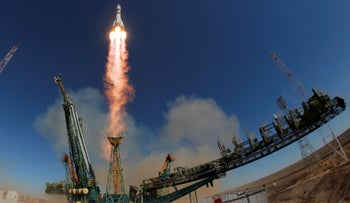 The Soyuz-FG rocket booster blasts off at the Russian leased Baikonur cosmodrome, Kazakhstan, October 11, 2018