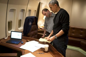 Former U.S. President Obama and Ben Rhodes, his deputy national security adviser, on board Air Force One, 2013.