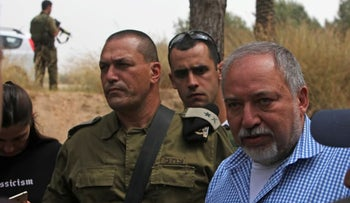 Defense Minister Avigdor Lieberman, right, with Maj. Gen. Eyal Zamir near Gaza, April 2018.