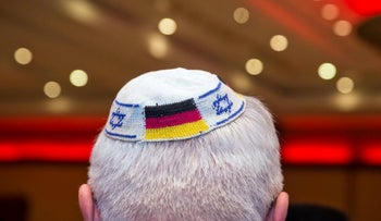 A man wearing a Jewish kippa skullcap with the flags of Germany and Israel in Frankfurt am Main, June 2014