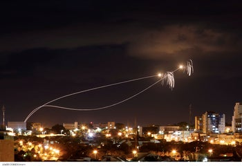 Iron Dome anti-missile system fires interception missiles as rockets are launched from Gaza toward Israel as seen from the city of Ashkelon, Israel, October 27, 2018.