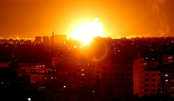 A fireball exploding during Israeli air strikes in Gaza City,  October 27, 2018.