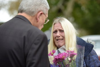 Denise Fulton, who lives outside of Pittsburgh, cries as she speaks with Bishop David Zubick after she came to show support for members of the community near the Tree of Life Synagogue on October 27, 2018