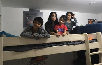 The Almakayais family at the bomb shelter in their house.