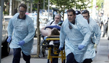 Paramedics transport a victim of a shooting at the scene of a shooting afternoon at the Jewish Federation of Greater Seattle, Friday, July 28, 2006.