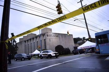 Police tape is viewed around the area outside the Tree of Life Synagogue after a shooting there left 11 people dead in the Squirrel Hill neighborhood of Pittsburgh, October 28, 2018.