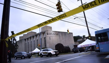 Police tape outside the Tree of Life Synagogue after a shooting there left 11 people dead in the Squirrel Hill neighborhood of Pittsburgh on October 27, 2018