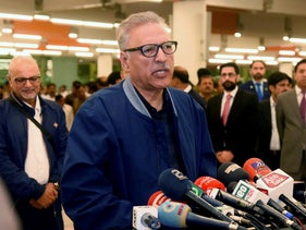 Pakistan's President Arif Alvi talks to journalists prior to departing to Turkey on a three-day visit, in Islamabad, Pakistan, Oct. 28, 2018.