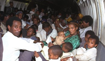 New Ethiopian immigrants on an Air Force Boeing jet en route from Addis Ababa to Israel during Operation Solomon