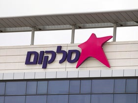 FILE PHOTO: The logo of Israel's biggest mobile phone operator Cellcom is seen on the Cellcom building in Netanya, north of Tel Aviv, Israel January 28, 2014.
