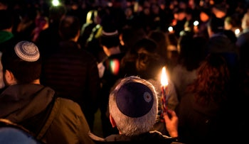 Members and supporters of the Jewish community hold a candlelight vigil in remembrance of the Pittsburgh synagogue shooting, Washington, October 27, 2018.