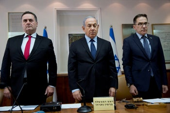 Israeli Prime Minister Benjamin Netanyahu, Transportation and Intelligence Minister Yisrael Katz (L), and Cabinet Secretary Tzachi Braverman stand for a moment of silence to honor the victims of a synagogue shooting in Pittsburgh, October 28, 2018.