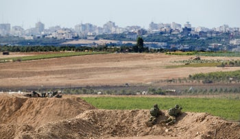 Israeli soldiers observe the Gaza Strip border, October 27, 2018.