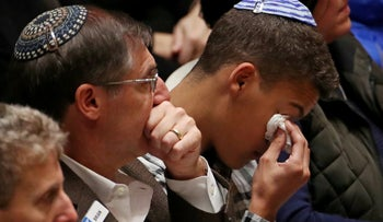 Mourners react during a memorial service at the Sailors and Soldiers Memorial Hall of the University of Pittsburgh, a day after 11 worshippers were shot dead at a Jewish synagogue in Pittsburgh, Pennsylvania, U.S., October 28, 2018. REUTERS/Cathal McNaughton     TPX IMAGES OF THE DAY