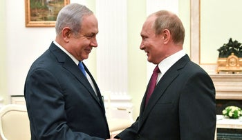 Russian President Vladimir Putin shakes hands with Israeli Prime Minister Benjamin Netanyahu during their meeting at the Kremlin in Moscow, July 11, 2018.