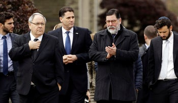 Pittsburgh Mayor Bill Peduto, second right and Israeli Ambassador to the U.S. Ron Dermer, third right, walk near the Tree of Life Synagogue in Pittsburgh, Sunday, Oct. 28, 2018.