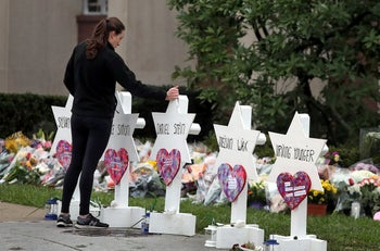 A woman reacts at a makeshift memorial outside the Tree of Life synagogue following Saturday's shooting at the synagogue in Pittsburgh, Pennsylvania, U.S., October 29, 2018
