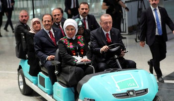 Turkish President Recep Tayyip Erdogan drives a car as he inaugurates a new aviation hub in Istanbul on October 29, 2018.