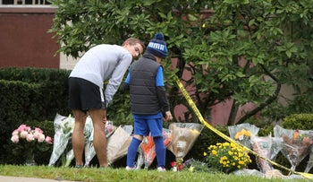 Children visit an impromptu memorial at the Tree of Life synagogue following Saturday's shooting at the synagogue in Pittsburgh, Pennsylvania, October 28, 2018.