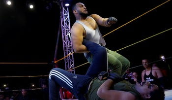 "Member of the Egyptian Arab Federation of Professional Wrestlers ""EWR"" Mohamed Samier, 28, in action with Androw Tharwat, 27, during a public fight in Ismailiya, north of Cairo, Egypt Oct. 26, 2018."