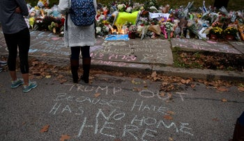 People pausing in front of at a memorial for victims of the mass shooting that killed 11 people and wounded 6 at the Tree Of Life synagogue in Pittsburgh, October 29, 2018.