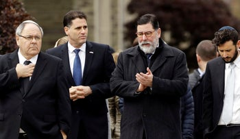 Pittsburgh Mayor Bill Peduto, second right and Israeli Ambassador to the U.S. Ron Dermer, third right, walk near the Tree of Life Synagogue in Pittsburgh, October 28, 2018.