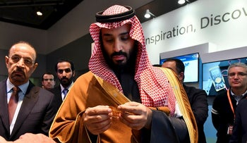 In this March 24, 20818, photo, Saudi Arabia Crown Prince Mohammed bin Salman tours an innovation gallery of Saudi Arabian technology, including an exhibit by King Abdullah University of Science and Technology, during a visit to Massachusetts Institute of Technology in Cambridge, Mass