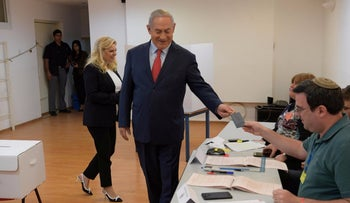 Prime Minister Benjamin Netanyahu and wife Sara Netanyahu voting in the local elections at a polling station in Jerusalem, October 30, 2018.