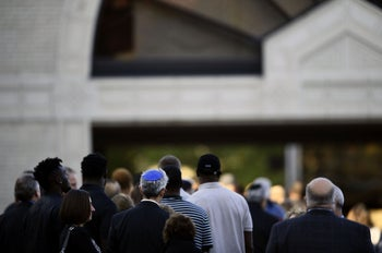 People arrive outside the Rodef Shalom Congregation where the funeral for Tree of Life Congregation mass shooting victims Cecil Rosenthal and David Rosenthal who are brothers will be held October 30, 2018 in Pittsburgh, Pennsylvania.