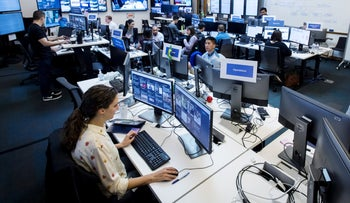 """Employees work inside the """"War Room"""" ahead of Brazil's runoff election at Facebook Inc. headquarters in Menlo Park, California, U.S., on Wednesday, Oct. 17, 2018."""