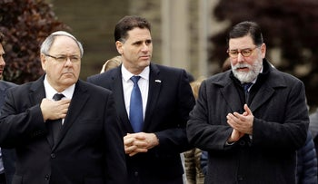 Israeli Ambassador to the U.S. Ron Dermer (center) and Pittsburgh Mayor Bill Peduto (right) walk near the Tree of Life Synagogue in Pittsburgh, Oct. 28, 2018.