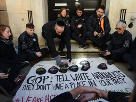 Protesters block entrance to the Metropolitan Republican Club in New York on Tuesday, October 30, 2018