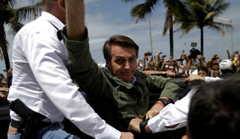 Brazilian President-elect Jair Bolsonaro waves to supporters after casting his vote, Rio de Janeiro, Brazil, October 28, 2018.