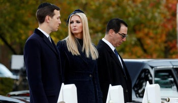 White House senior advisers Jared Kushner, left, and his wife Ivanka Trump standing with U.S. Treasury Secretary Steven Mnuchin at a makeshift memorial to the 11 victims outside the Tree of Life synagogue in Pittsburgh, October 30, 2018.