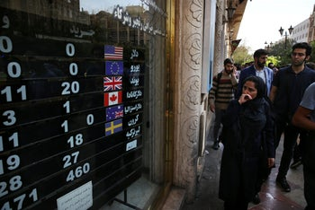 An exchange shop displays rates for various currencies, in downtown Tehran, Iran. Oct. 2, 2018