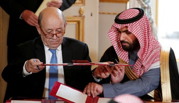 French Minister for Foreign Affairs Jean-Yves Le Drian and Prince Badr Bin Abdullah Al Saud (R) attend a signature ceremony in Paris, France, April 10, 2018.