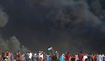 Palestinian demonstrators take part in a protest at the Israel-Gaza border August 3, 2018