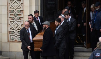 Caskets are carried out of Rodef Shalom Temple following the funeral of brothers Cecil Rosenthal, 59, and David Rosenthal, 54, in Pittsburgh, October 30, 2018.