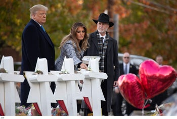 President Donald Trump and First Lady Melania Trump, alongside Rabbi Jeffrey Myers, pay their respects at the Tree of Life Synagogue in Pittsburgh, Pennsylvania, October 30, 2018.