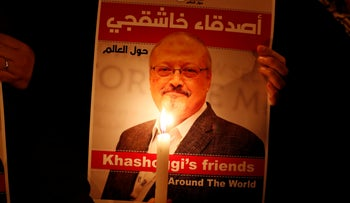 A demonstrator holds a poster with a picture of Saudi journalist Jamal Khashoggi outside the Saudi Arabia consulate in Istanbul, Turkey, Oct. 25, 2018.