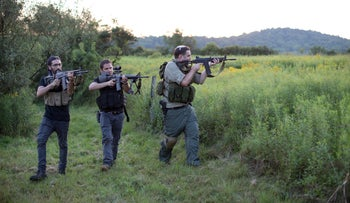 Jonathan Stern (R) and two other trainees demonstrate a takeover exercise against a hostile element as they take part in the Cherev Gidon Firearms Training Academy in Honesdale, PA, U.S. Aug. 5, 2018.