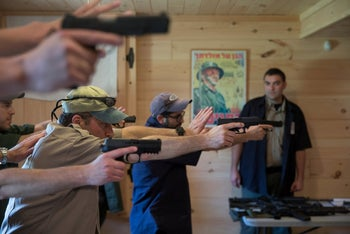 Trainees practice an Israeli shooting method as they take part in the Cherev Gidon Firearms Training Academy in Honesdale, Pennsylvania, U.S. August 5, 2018.