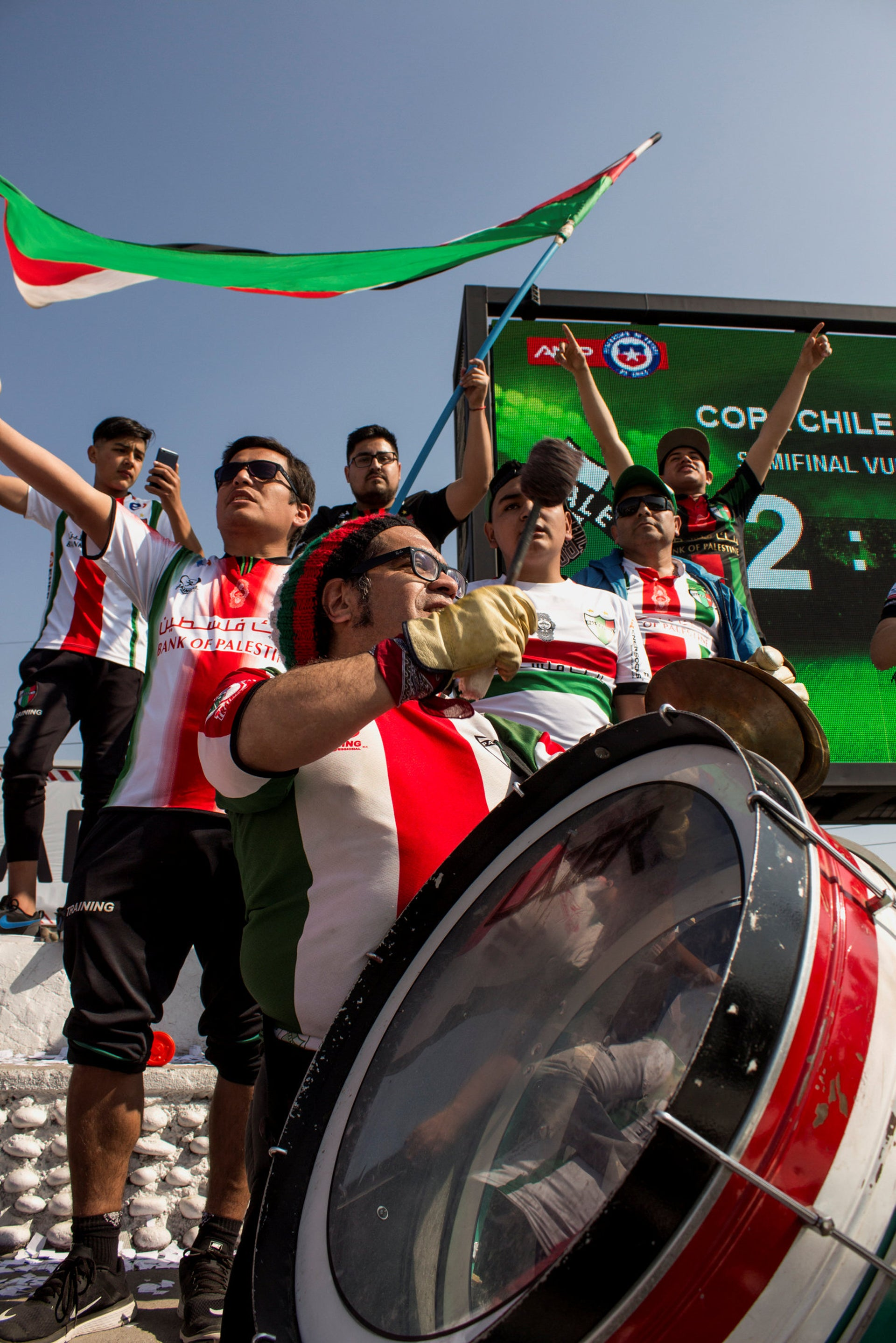 People attend a Deportivo Palestino soccer game. The team was founded a century ago by Palestinian immigrants.