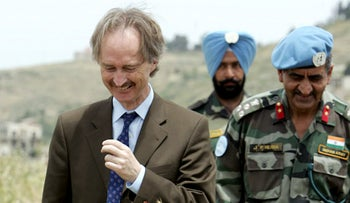 In this file photo taken on May 10, 2007, UN Special Representative in Lebanon Geir Pedersen (L) walks in a field in the southern Lebanese village of Tebnin during a tour to UN peacekeeping forces.